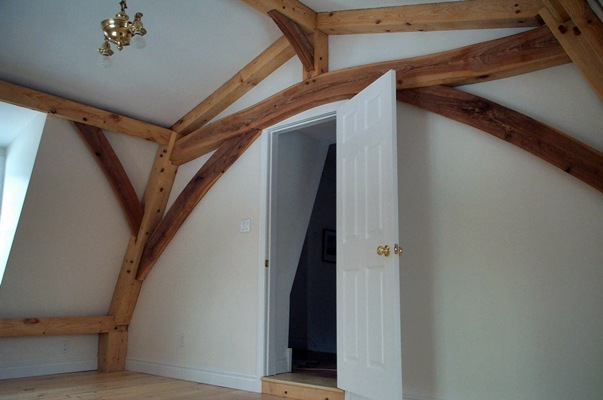 <b>Hudson, Quebec</b><br>Arched timber collar over doorway